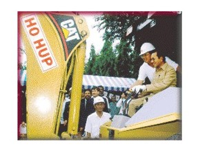 The Prime Minister operating the excavator